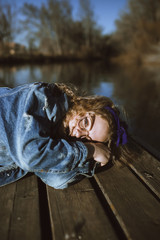 Pretty woman lying on quay