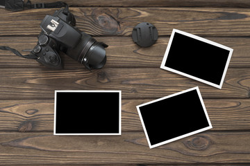photo camera on a wooden background.