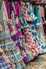 Colorful traditional flamenco sevillana dresses.