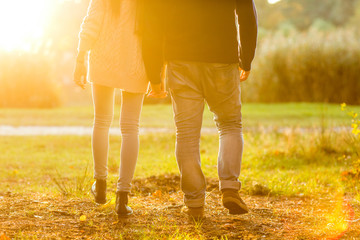 couple in love in autumn park having fun at sunset