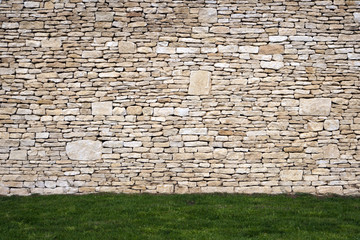 Brand new cotswold drystone wall and lawn