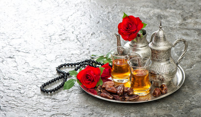 Tea table red rose flowers dates Islamic holidays decoration
