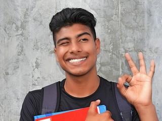 Latino Boy Student And Okay Sign