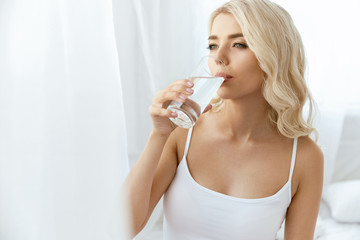 Drinking Water. Woman With Glass Of Water.