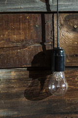 incandescent light bulb on wooden background