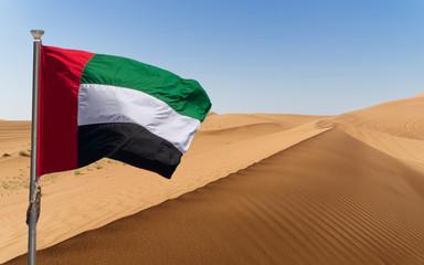 UAE flag with hypnotic patterns of sand desert in the UAE desert, near Dubai, UAE