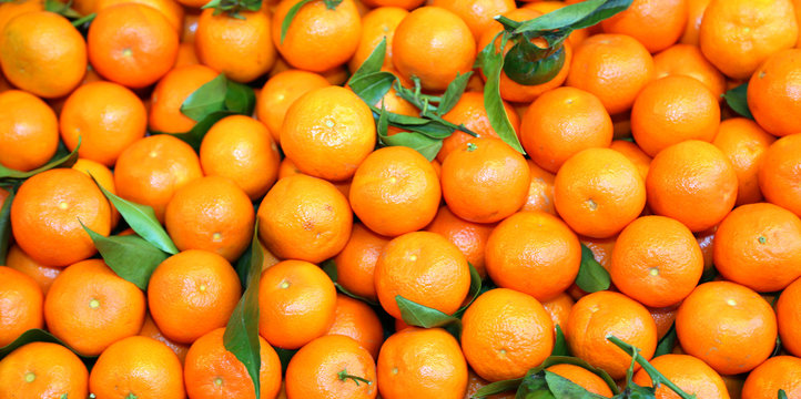 perfect background of ripe clementines for sale at the market