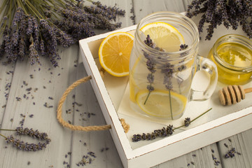 Lavender  tea with honey and lemon on the white  wooden  tray