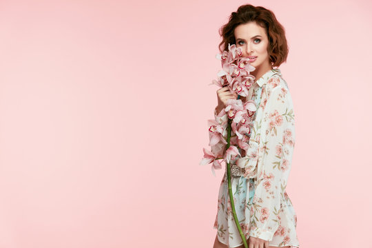 Spring Fashion. Woman With Flowers In Fashionable Clothes