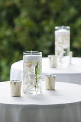 Table decorations with orchids in water for reception