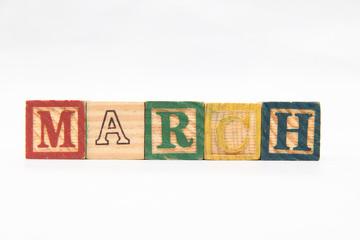 """composing letters into one word, """"March""""."""