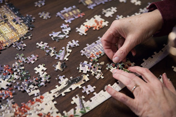 A senior citizen participates puts together a puzzle at a nursing home