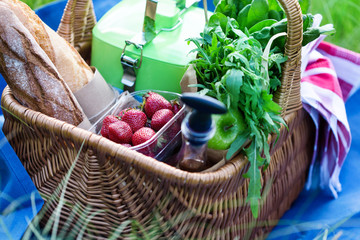 Picnic basket with snacks for meal with outdoor entertainment, selective focus