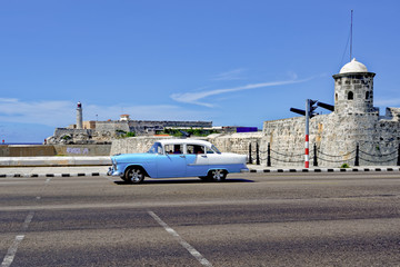 Taxi passing Havana's forts