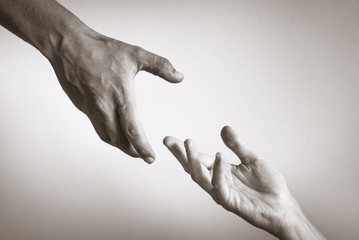 Hand helping hand concept. Hope, love, rescue concept.