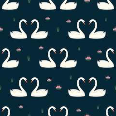 Trendy seamless pattern with white swans in love and water lily on dark blue background. Night lake art background. Fashion design for fabric, wallpaper, textile and decor.