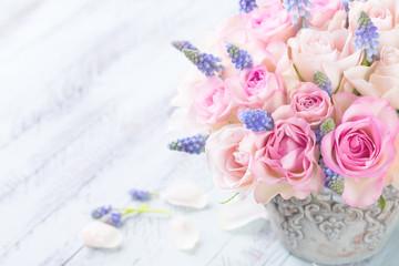 Romantic flower bouquet on light wooden background