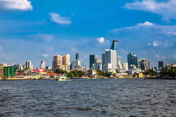 Fototapete - Business district cityscape from Jaopraya river in Bangkok