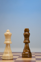 King and queen pieces on chess board