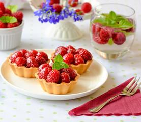 Mini tarts with raspberries fruits