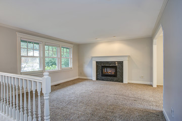 Light open living area with traditional fireplace