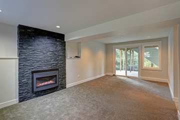 Fully renovated living area with black fireplace
