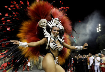A reveller from the Independente Samba School takes part in a carnival at Anhembi Sambadrome in Sao Paulo
