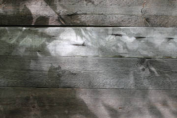 Wood wall with sun light and shade on surface. Texture background