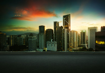 Asphalt road side with beautiful Kuala Lumpur city skyline. Sunrise scene .