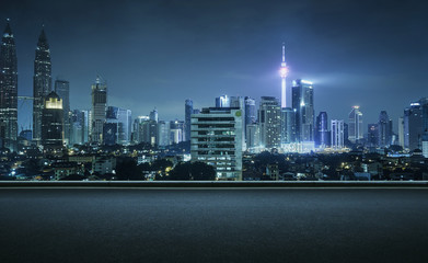 Asphalt road side with beautiful Kuala Lumpur city skyline. Night scene .