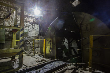 Underground iron ore mine shaft tunnel gallery with  rotary car dumper ore car