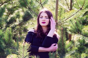 Fashion model in black dress in the summer dressed in a black dress
