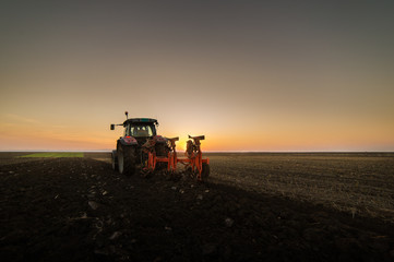 Tractor plowing plow the field