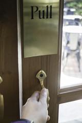 Hand pull door to outdoor seat