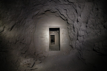 Underground abandoned gold ore mine shaft tunnel gallery with door