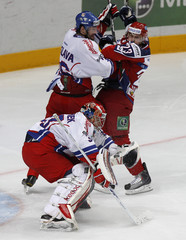 Czech Republic's goalkeeper Stepanek waits for a shot, with his teammate Caslava and Russia's Kokarev struggling in the background, during their Channel One Cup ice hockey game at Megasport arena in Moscow