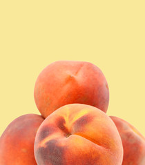 Ripe peach fruit isolated on yellow background cutout