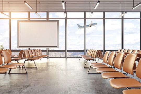 Modern airport interior with blank poster
