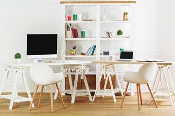 Stylish loft interior with workplace