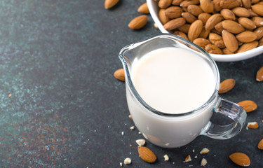 Almond milk in a milk pitcher, high angle view