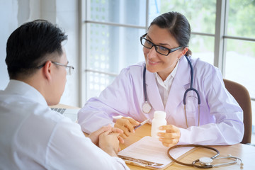 Senior Female doctor consults young Patient sitting at doctor office. Diagnostic, prevention of women diseases, healthcare, medical service, consultation or education, healthy lifestyle concept
