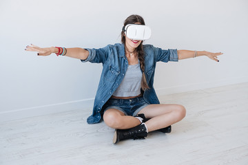 Flying girl while using VR glasses
