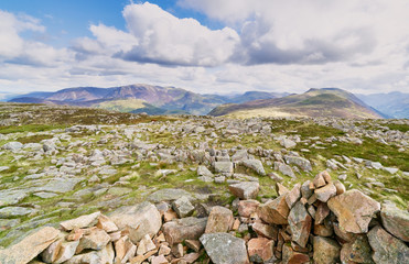 Views from the summit shelter of Great Borne with the summits of Grasmoor, Robinson and Red Pike in the distance in the English Lake District.