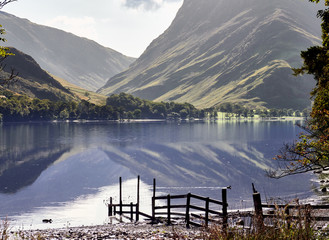 Views of Fleetwith Pike and Honister from the shore of Lake Buttermere in the English Lake District on a summers day, UK.