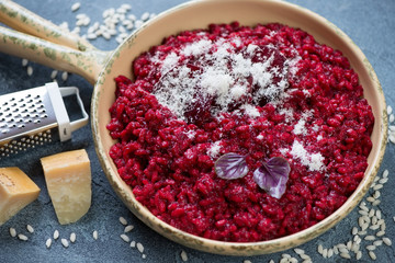 Risotto with beetroot topped with grated parmesan cheese, selective focus, studio shot