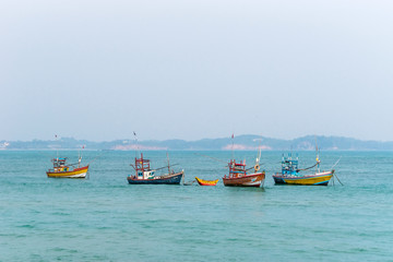 Traditional wooden fishing boats in the ocean. Southern Sri Lanka.