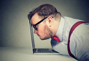 Man having vision problem when working