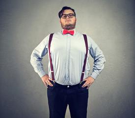 Overconfident chubby man in bowtie