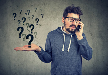 Confused man having phone call