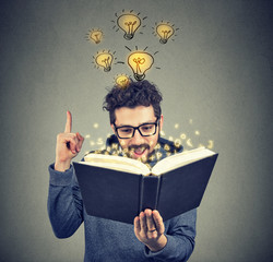 Smart man inspired with idea from book
